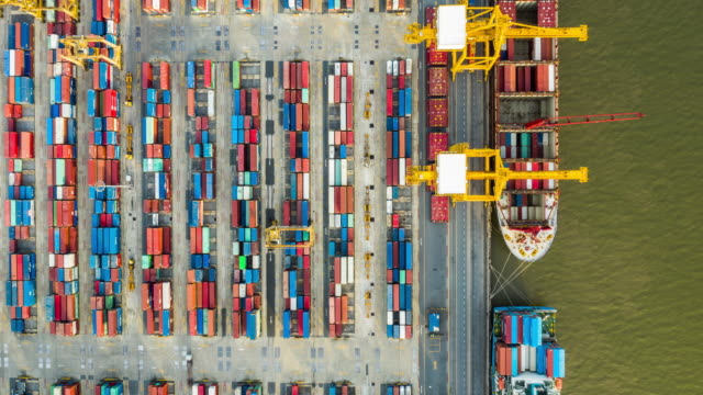 Hyperlapse top view of Commercial container port Hyperlapse or drone timelapse top view dolly shot of Bangkok Thailand commercial container port in day time. harbor stock videos & royalty-free footage