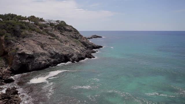 ibiza cliffs, image made from the top of an ibiza cliff - formaggio comté video stock e b–roll