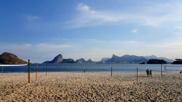 Icarai Beach in Niteroi Rio de Janeiro landscape in the background: Sugarloaf, Corcovado Mountain and Pedra da Gavea. cristo redentor stock videos & royalty-free footage