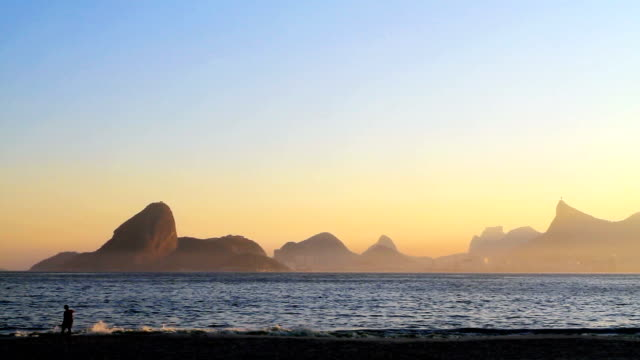 Icarai Beach in Niteroi From left to right: Sugarloaf, part of Two Brothers Mountain, Pedra da Gavea and Corcovado with Christ the Redeemer at the top. cristo redentor stock videos & royalty-free footage