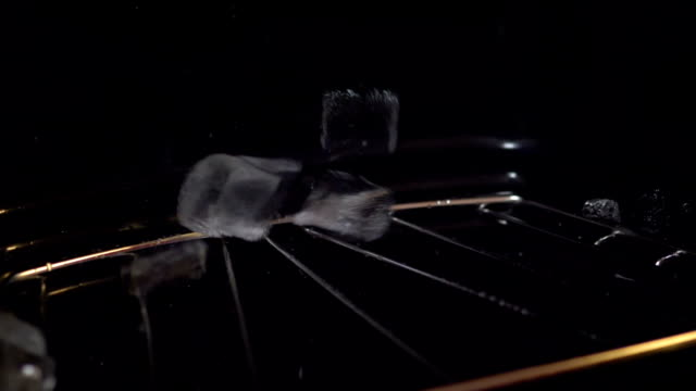 Ice Cubes Falling From Refrigerator in slow motion 180fps video