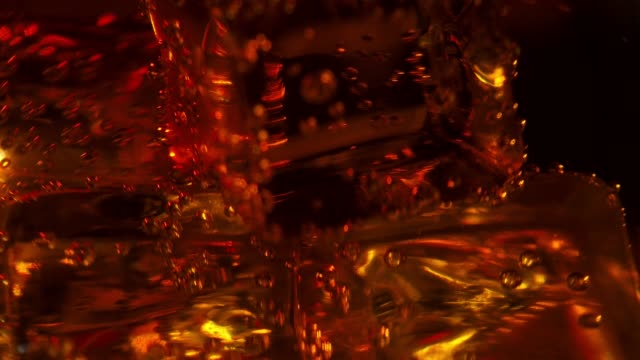 ice cubes in the glass of whiskey and soda - brandy video stock e b–roll