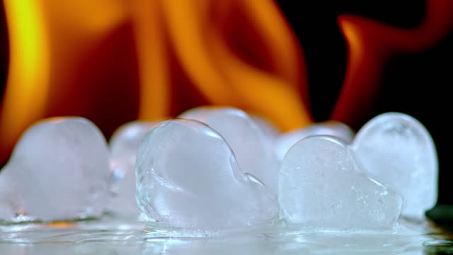 slo mo ld ice cubes melting in fire - ice on fire video stock e b–roll