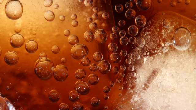 Ice Cubes Close up of Carbonated soft drink with ice cubes cola stock videos & royalty-free footage