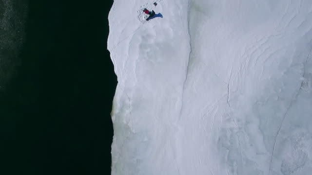 ice fishing amateur winter sports fun - ghiaccio galleggiante video stock e b–roll