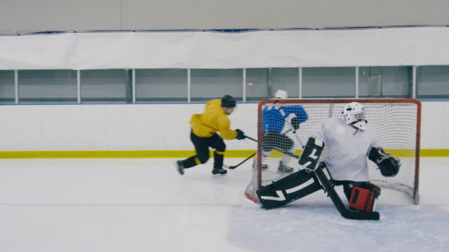Ice hockey player hitting the post Tracking shot of professional ice hockey players moving near goal, but puck hitting the post goal post stock videos & royalty-free footage