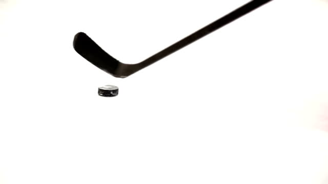 ice hockey player playing a puck. - hockey stock videos and b-roll footage
