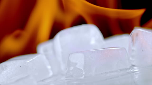 slo mo ld ice melting in fire flames - ice on fire video stock e b–roll