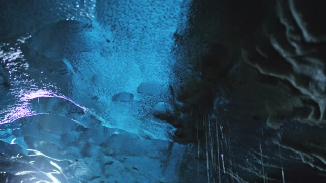 MS Ice melting in ice cave Ice melting in ice cave. RL pan,Tilt Up,Real Time. Shot in 8K resolution. cave stock videos & royalty-free footage