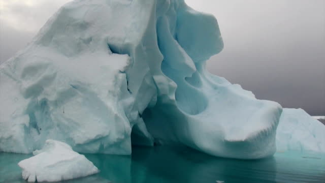 Iceberg and ice floe in ocean of Antarctica. video