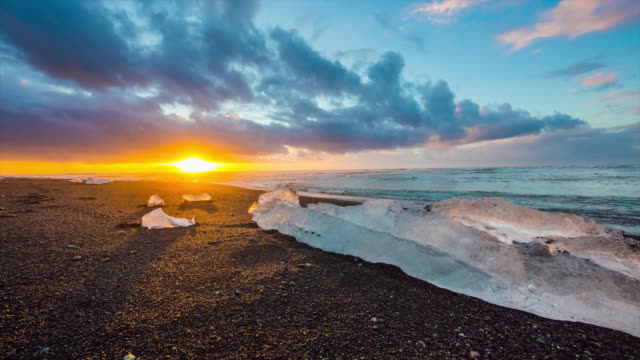 T/L 8K Icebergs on black beach at sunrise video