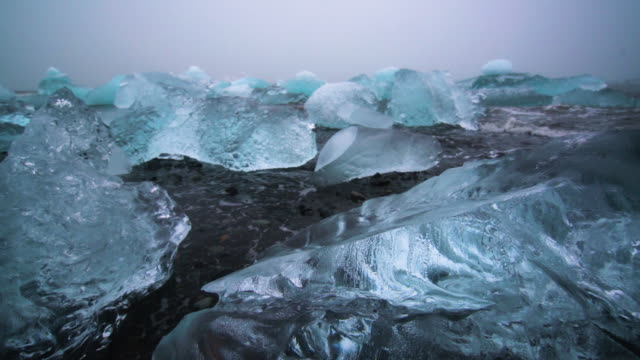 icebergs on diamond beach in iceland. - antarctica travel stock videos & royalty-free footage