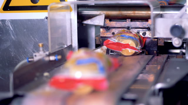 ice-cream packaging conveyor in a modern production line. - cibi e bevande video stock e b–roll