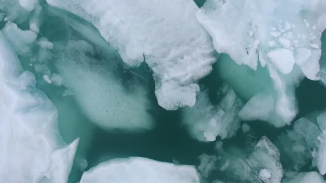 laguna di jokulsarlon in islanda - ghiaccio galleggiante video stock e b–roll