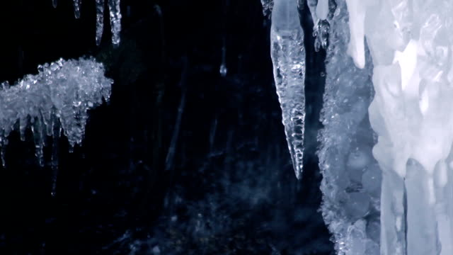 Icicles and water drops. Winter waterfall. Winter icicles. Melting ice video