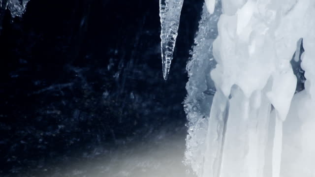 Icicles. Melting ice. Spring rain. Closeup. Spring icicles. Spring background video