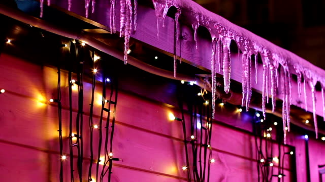 Icicles on the roof of the house. video