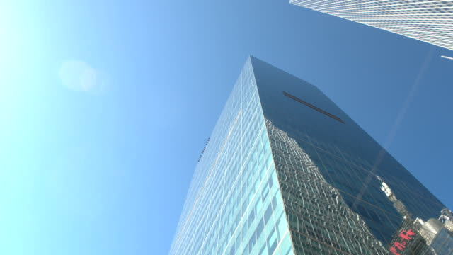 CLOSE UP: Iconic 1 WTC building reflecting in glassy skyscraper on sunny day video