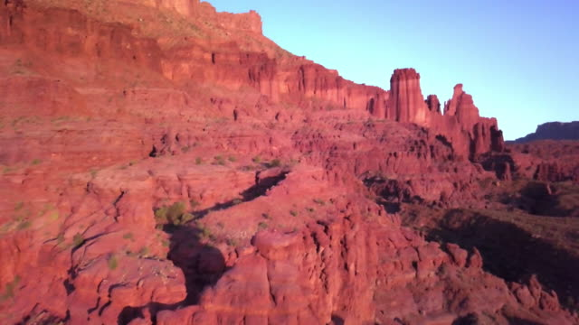 iconic fisher towers sandstone red rock formation near moab utah - red rock video stock e b–roll