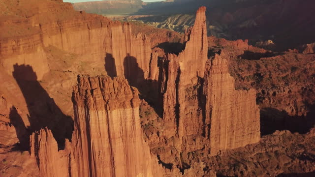 iconic fisher towers sandstone red rock formation near moab utah - utah video stock e b–roll