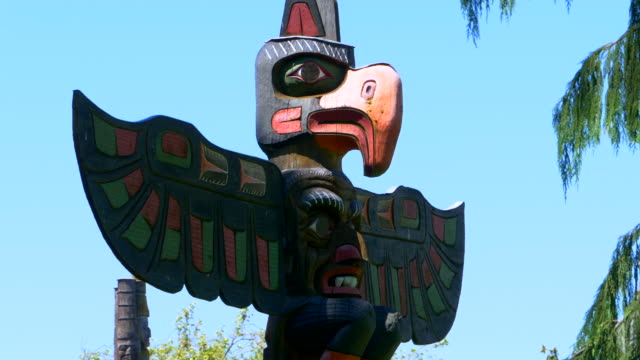 Iconic Totem Pole, Thunderbird Historic Native American Pole Carving Art Iconic Totem Pole, Thunderbird Historic Native American Pole Carving Art vancouver canada stock videos & royalty-free footage