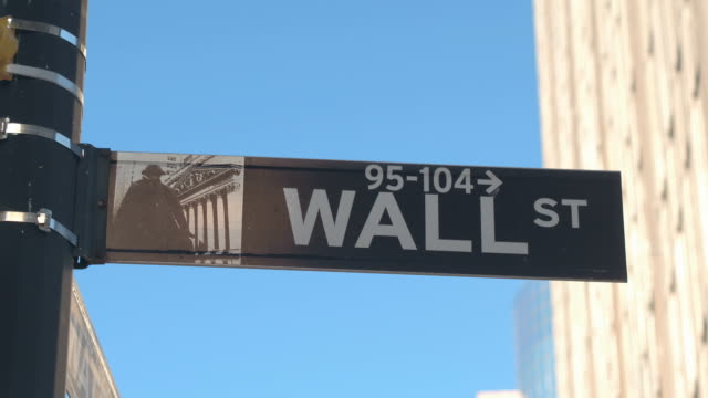 CLOSE UP: Iconic Wall Street sign in Lower Manhattan New York financial district CLOSE UP: Street sign of iconic Wall Street, a collective name for the financial and investment community, stock exchanges, large banks, brokerages, securities, underwriting firms and big businesses wall street stock videos & royalty-free footage