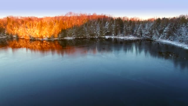 Icy lake in March, light of dawn just arriving video