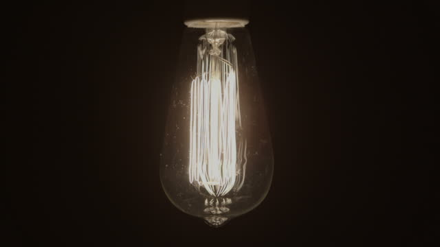 Idea Concept Vintage light bulb turns on and off slowly