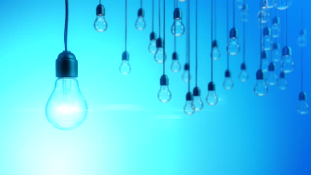 Idea concept with light bulbs on blue background video