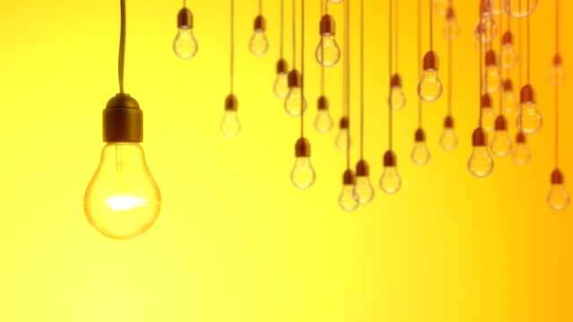 Idea concept with light bulbs on yellow background video