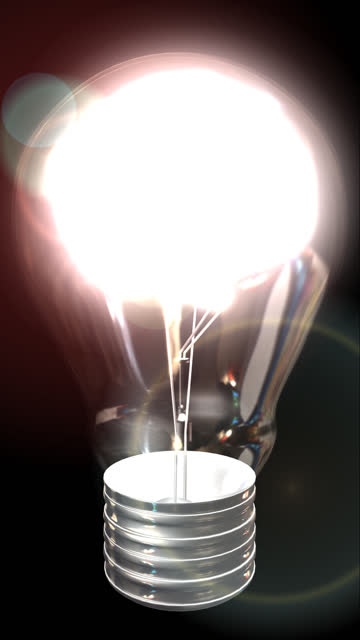 Ideas Light Bulb With a Brain (Vertical Format) Camera moves round a lightbulb containing a brain. Brain lights up.  cerebellum stock videos & royalty-free footage