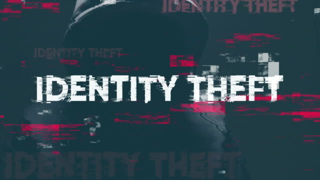 Identity theft Identity theft concept with faceless hooded male person, low key footage with digital glitch effect identity theft stock videos & royalty-free footage
