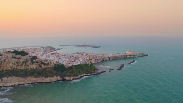 ws aerial view idyllic coastal town and sea at sunset, vieste, italy - итальянская культура стоковые видео и кадры b-roll
