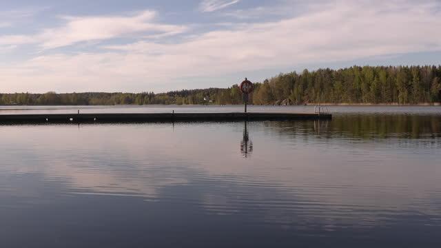 Idyllic shot of a floating swimming bridge on a lake on a sunny day.