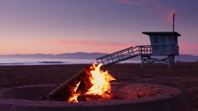 Idyllic Sunset Beach Bonfire - video
