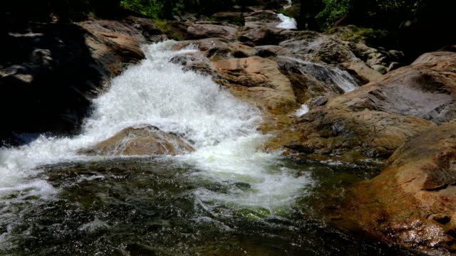 Idyllic waterfall and amazing nature at Thailand, 4K. Shot of The stream flows from the waterfall. nakhon si thammarat stock videos & royalty-free footage
