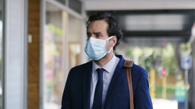if you're going to be out, protect yourself - businessman covid mask video stock e b–roll