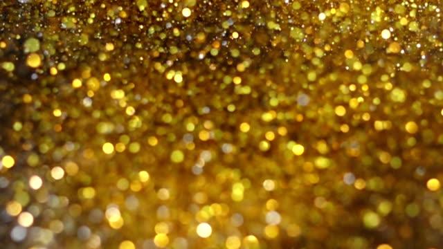 ig Explosion Golden Glitter Dust Tiny reflect light in the Air, Dark black background