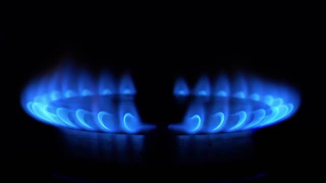 4k - ignition of a blue flame on gas stove - gaz filmów i materiałów b-roll