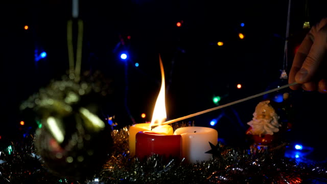 Ignition of New Year's candles, a long match. On the eve of Christmas. Home holiday. video