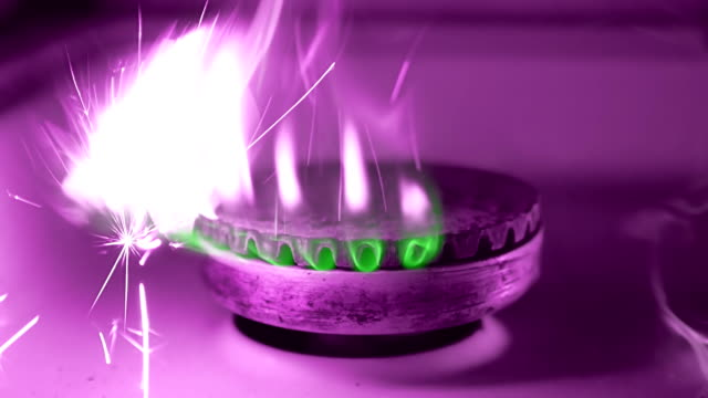 Ignition of the gas from the burner gas kitchen stove by magnesium flint video