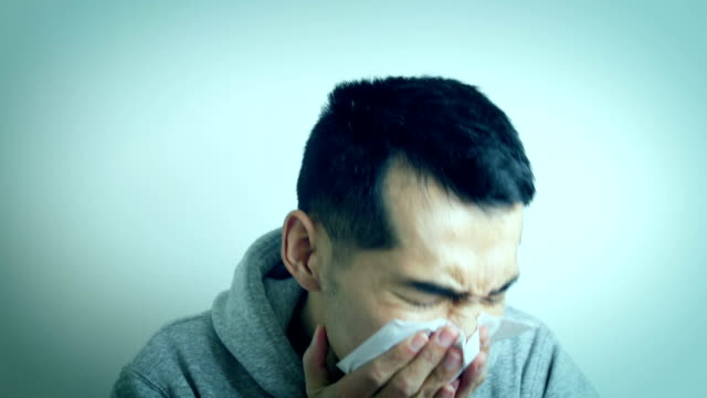 Illness young man coughing Illness young man coughing coughing stock videos & royalty-free footage