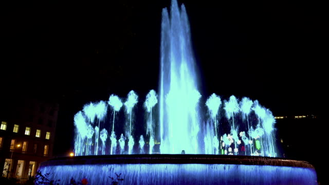 Illuminated dancing fountain, beautiful water and music show, tourist attraction video