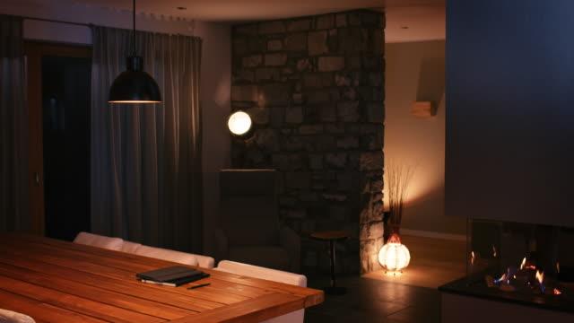Illuminated dining room at smart home