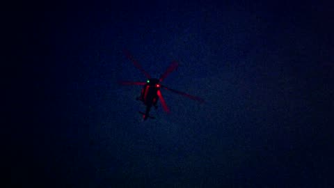 Illuminated helicopter flying above city in the night The police helicopter watches over. Night. helicopter stock videos & royalty-free footage