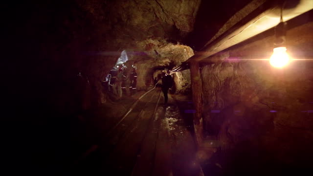 Illuminated long tunnel of a mine video