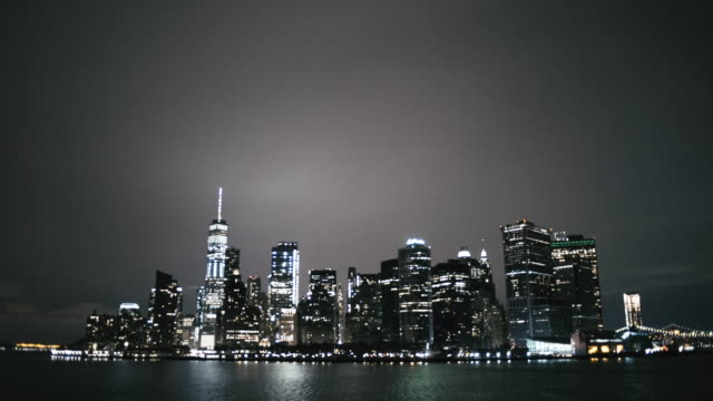 Illuminated New York city at waterfront in night
