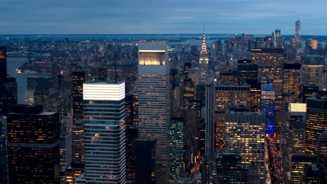 AERIAL: Illuminated New York City skyscrapers in Midtown Manhattan at night video