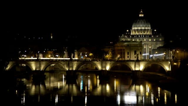 illuminated saint peter basilica church, vatican city, beautiful night landscape - papa video stock e b–roll