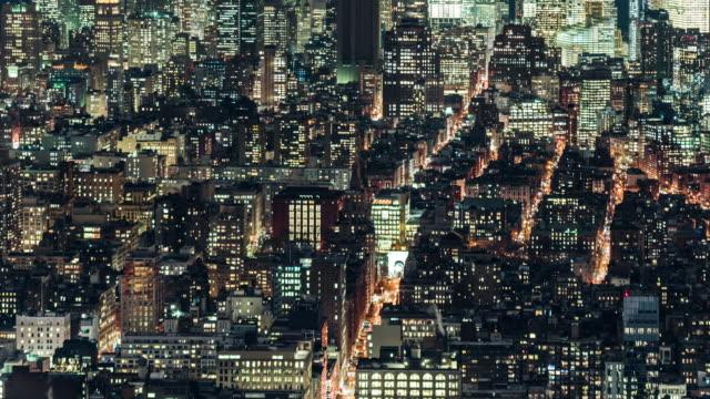 vídeos y material grabado en eventos de stock de t/l ha zo iluminados rascacielos en manhattan en la noche / nyc - prosperidad